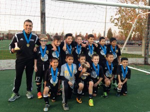 Coach John Bustos and the U10B Black, Copa del Rey tournament champions!