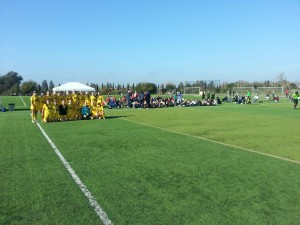 Placer United gets ready to take the field with a sideline full of college coaches.