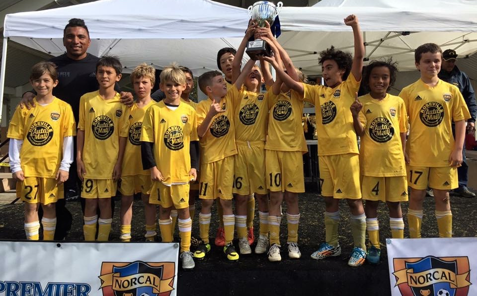 U10B 05 Black celebrate the win with Coach Jorge