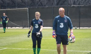 Coach Matt McDougall finishes warming up Irish goalkeeper Niamh Reid Burke
