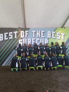 The 98G Gold show off the coveted champions jackets well earned at the 2016 soccerloco Surf Cup tournament in San Diego