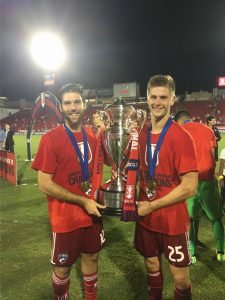 Placer alumni player, Ryan Hollingshead (left) with the US Open Cup Trophy